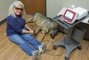 Donna treating with laser therapy